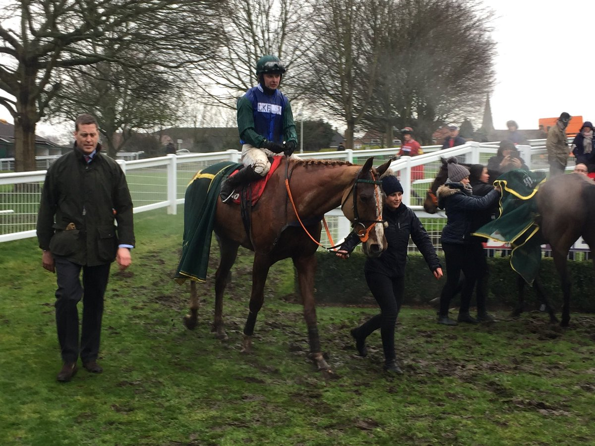 Ballydine returning to the winners enclosure after winning The Betfred Masters Chase